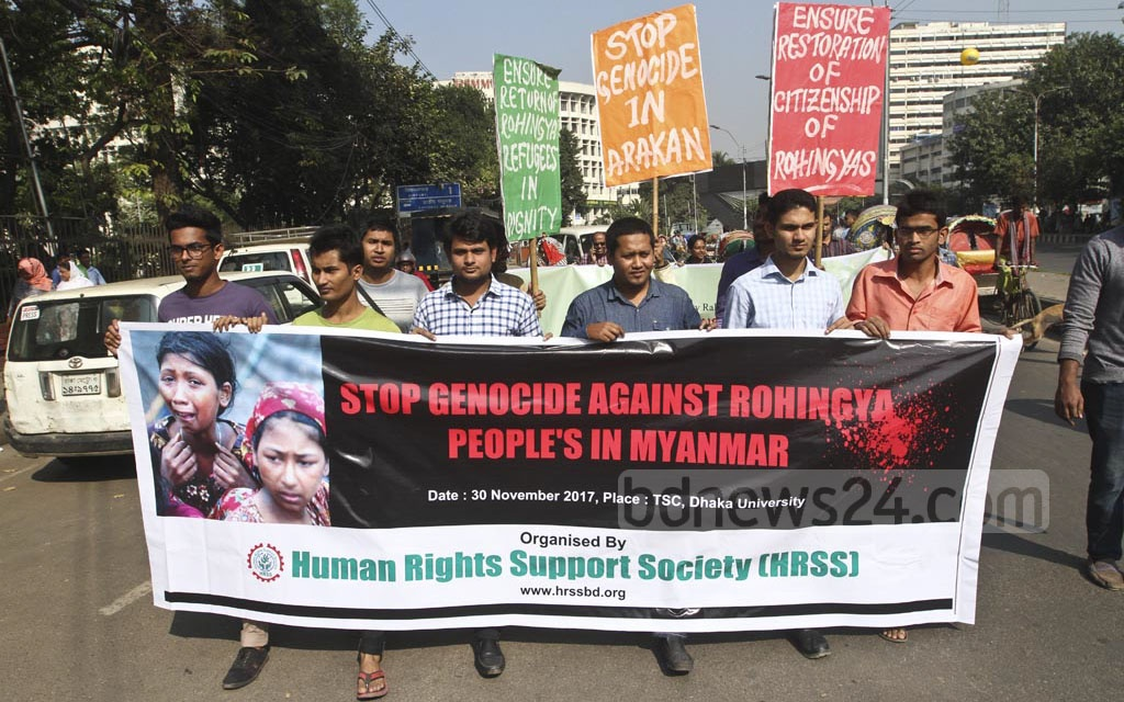 Euro-Burma, a Europe-based Rohingya group, and the Refugee and Migratory Movement Research take out a procession in Dhaka on Thursday calling an end to the persecution of the Rohingya people in Myanmar's Rakhine State. Photo: dipu malakar
