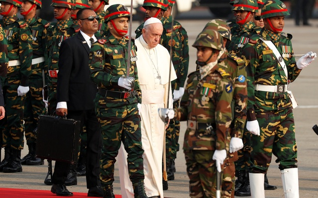 Pope Francis inspects honour guards after arriving at the airport in Dhaka, Bangladesh Nov 30, 2017. Reuters