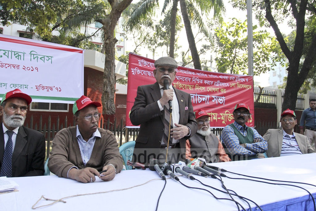Sector Commanders' Forum Chairman KM Shafiullah addressing a rally at the Martyred Intellectuals Memorial in Dhaka on Friday observing what it describes as Freedom Fighters' Day, observed on Dec 1 every year. Photo: asif mahmud ove