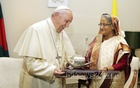 Prime Minister Sheikh Hasina hands over a memento, Awami League's election symbol 'boat', to Pope Francis during her meeting with the pontiff at the Vatican embassy at Baridhara diplomatic enclave in Dhaka on Friday. Pope Francis is in Bangladesh on a three-day visit. Photo: Saiful Islam Kallol