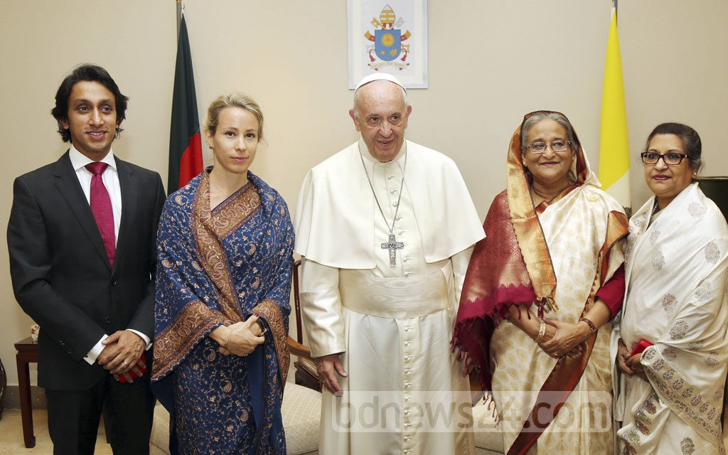 Prime Minister Sheikh Hasina and her sister Sheikh Rehana pose for a photograph with Pope Francis at the Vatican embassy at Baridhara diplomatic enclave in Dhaka on Friday. Sheikh Rehana's son Radwan Mujib Siddiq and daughter-in-law Peppi Siddiq are also seen in the picture. Pope Francis is on a three-day visit to Bangladesh. Photo: Saiful Islam Kallol