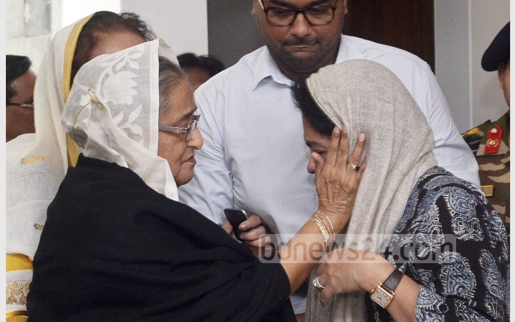Prime Minister Sheikh Hasina condoles with the family of Dhaka North Mayor Annisul Huq after the coffin bearing his body arrives at his home in Dhaka on Saturday. Photo: PMO