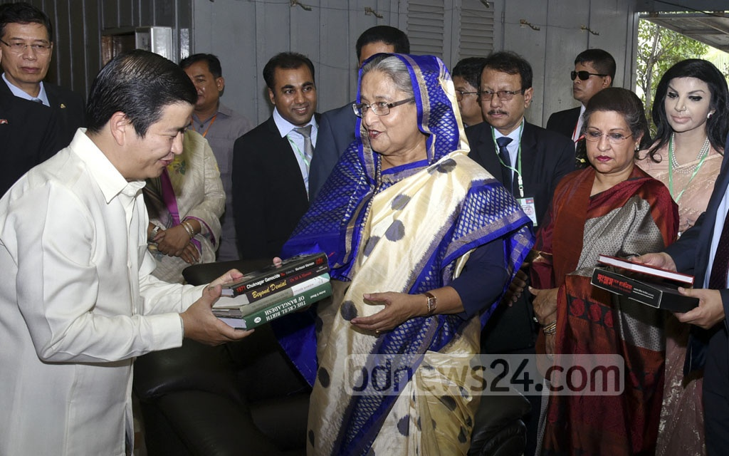 Prime Minister Sheikh Hasina hand over some books on Bangladesh's history of independence to the Tuol Sleng Genocide Museum on Sunday, the first day of her three-day official visit to Cambodia. Photo: Saiful Islam Kallol