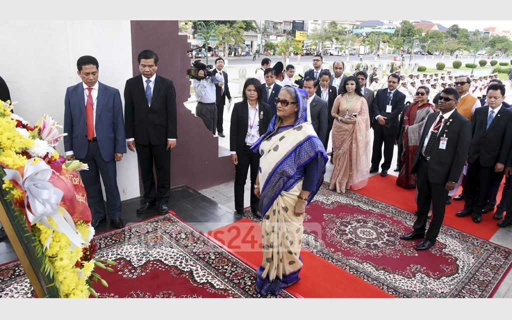 Prime Minister Sheikh Hasina places wreaths on Sunday at the Independence Monument and statue of King Norodom Sihanouk, known to the Cambodian people as Samdech Euv or 'father prince' during her three-day official visit to the south-east Asian country. Photo: Saiful Islam Kallol