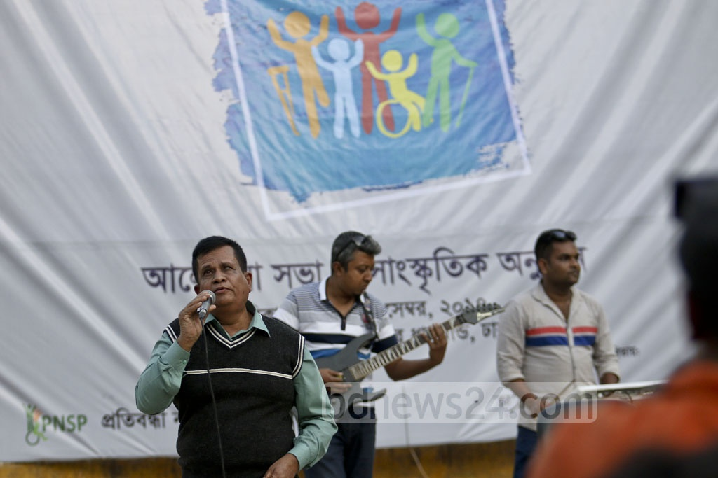 A physically-challenged artist rendering songs at the cultural programme organised in observance of International Day of Persons with Disabilities at the Rabindra Sarobar in Dhaka on Sunday. Photo: tanvir ahammed