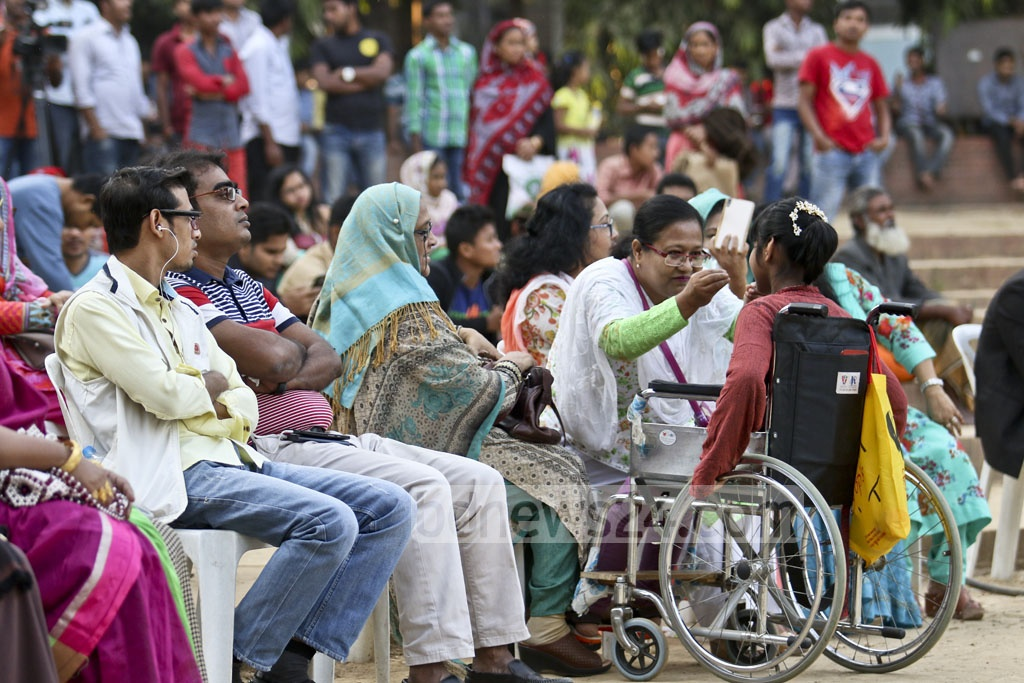 Council of Organisations for Citizens with Disabilities organises a discussion meeting and cultural function at the Rabindra Sarobar on Sunday in Dhaka in observance of International Day of Persons with Disabilities. Physically challenged artists perform at the programme. Photo: tanvir ahammed
