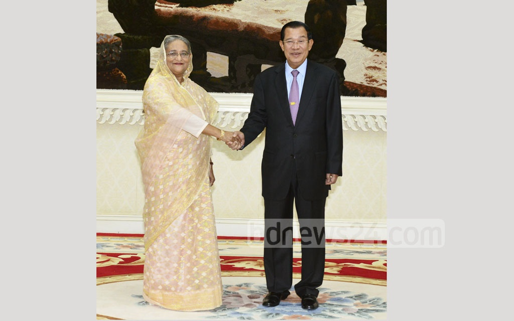 Prime Minister Sheikh Hasina and her Cambodian counterpart Hun Sen shake hand at his office Peace Palace in Phnom Penh on Monday. Photo: Saiful Islam Kallol