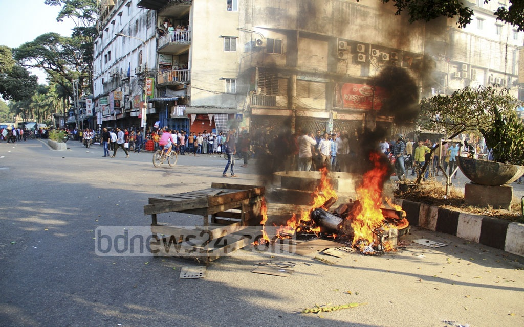 BNP activists vandalise vaicals as they clash with police in Dhaka's Bangabazar area on Tuesday.