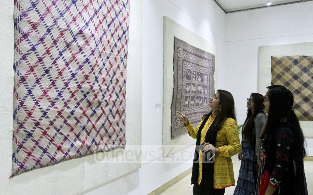 A section of the visitors at the seven-day Sheetal Pati (a traditional mat made of materials from murta plants) exhibition opened at the National Museum at Shahabagh in Dahaka on Tuesday. Photo: dipu malakar