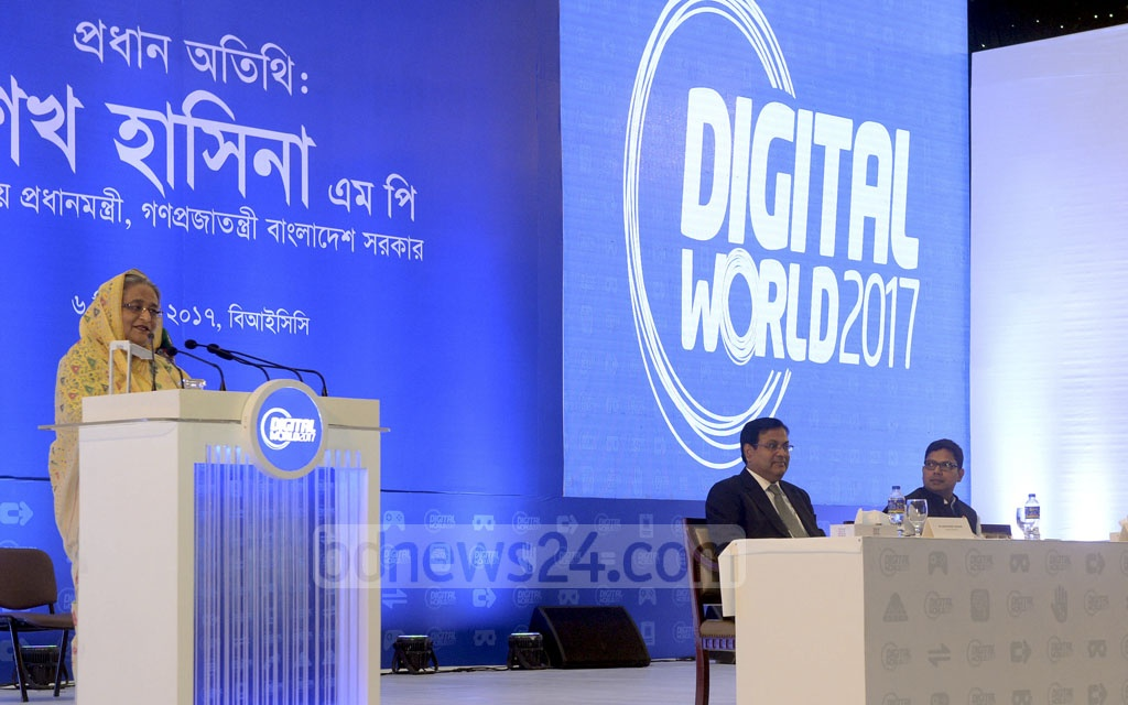Prime Minister Sheikh Hasina addresses the inaugural session of the four-day Digital World 2017 exposition at Dhaka's Bangabandhu International Conference Centre on Wednesday. Photo: PID