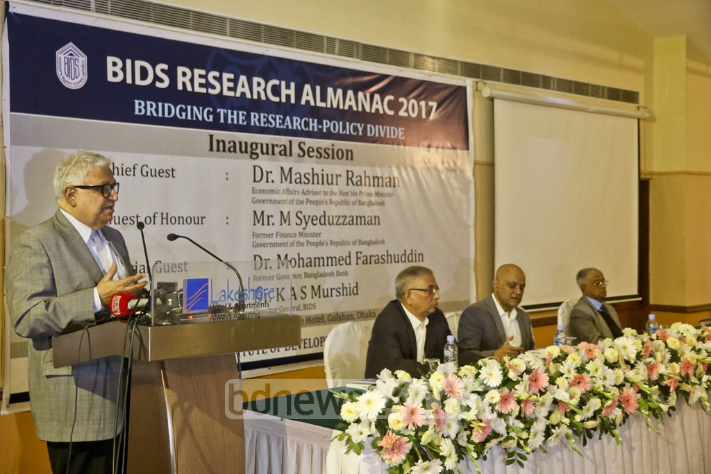 Economic Affairs Adviser to the PM Mashiur Rahman addressing the inaugural session of the two-day seminar by Bangladesh Institute of Development Studies or BIDS at the Lakeshore Hotel Dhaka on Wednesday. Photo: tanvir ahammed