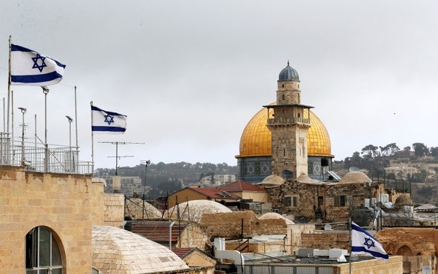 Israeli flags are seen near the Dome of the Rock (rear), located in Jerusalem's Old City on the compound known to Muslims as Noble Sanctuary and to Jews as Temple Mount, December 6, 2017. Reuters