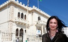 Maltese investigative journalist Daphne Caruana Galizia poses outside the Libyan Embassy in Valletta Apr 6, 2011. Investigative journalist Caruana Galizia was killed after a powerful bomb blew up a car killing her in Bidnija, Malta, in Oct 16, 2017. Reuters