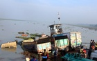Bus, trucks sink into river after barge rams ferry in Pirojpur