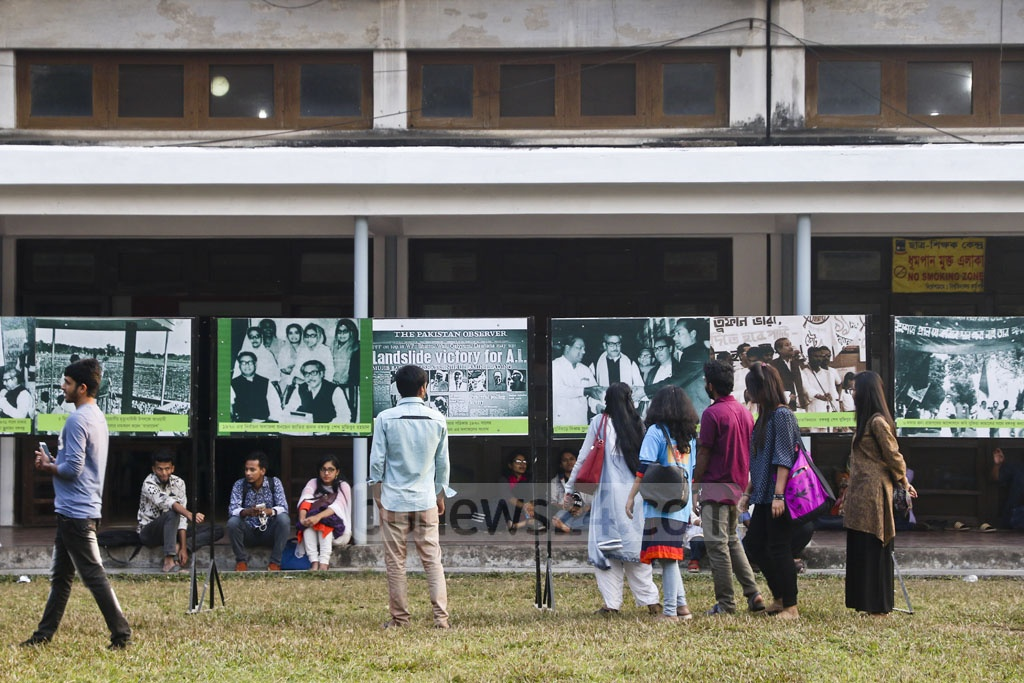 Visitors at a photography exhibition titled 'History Speaks: Bangabandhu from Struggle to Independence' organised by Father of the Nation Bangabandhu Sheikh Mujibur Rahman Memorial Trust at the Dhaka University TSC premises on Thursday. Photo: tanvir ahammed