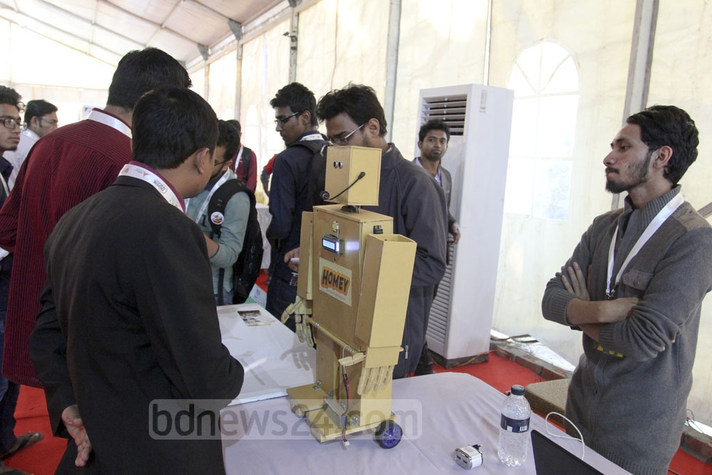 Visitors were no less curious to know about locally made robots exhibited at the Digital World-2017 on Thursday. World's first robot citizen Sophia became the centre of attraction during the inauguration on Wednesday. Photo: asif mahmud ove
