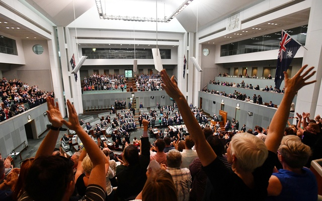 Members celebrate before the passing of the Marriage Amendment Bill in the House of Representatives at Parliament House in Canberra Dec 7, 2017. AAP via Reuters