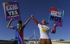 Same-sex marriage campaigners pose for pictures during an equality rally outside Parliament House in Canberra December 7, 2017. AAP via Reuters