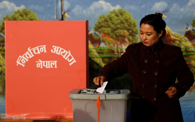 A woman casts her vote during the parliamentary and provincial elections in Bhaktapur, Nepal Dec 7, 2017. Reuters