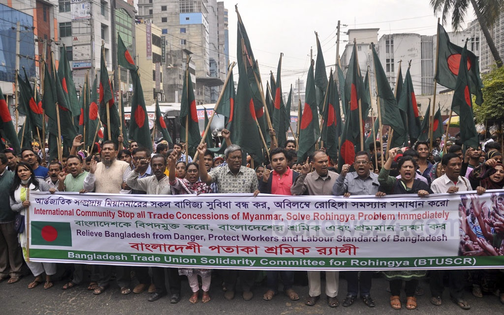 A workers' platform takes out a procession carrying the national flag in front of the National Press Club on Friday calling upon the international community to mount more pressure on Myanmar to take back the Rohingya refugees.
