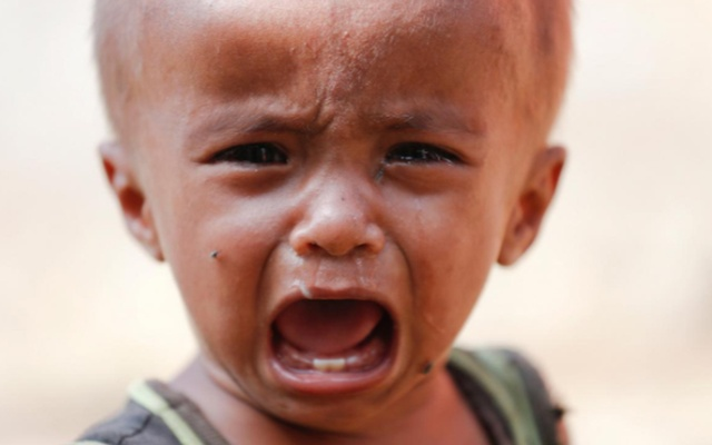A Rohingya refugee child cries at the camp for widows and orphans inside the Balukhali camp near Cox's Bazar, Bangladesh December 5, 2017. Reuters