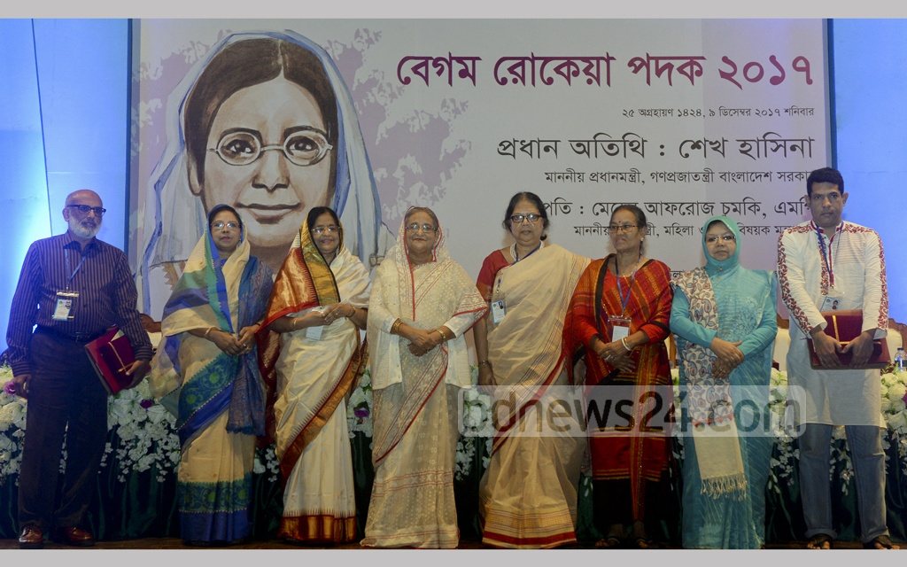 Prime Minister Sheikh Hasina poses for a photograph with the recipients of this year's Begum Rokeya Padak—the national honour for women's achievements at Dhaka's Osmani Memorial Auditorium on Saturday .