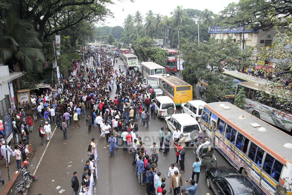 Demonstrators leave little space for vehicles to move on the busy road along the National Press Club. Activists of different organisations filled more than half of the street to mark the International Human Rights Day on Sunday. Photo: asif mahmud ove