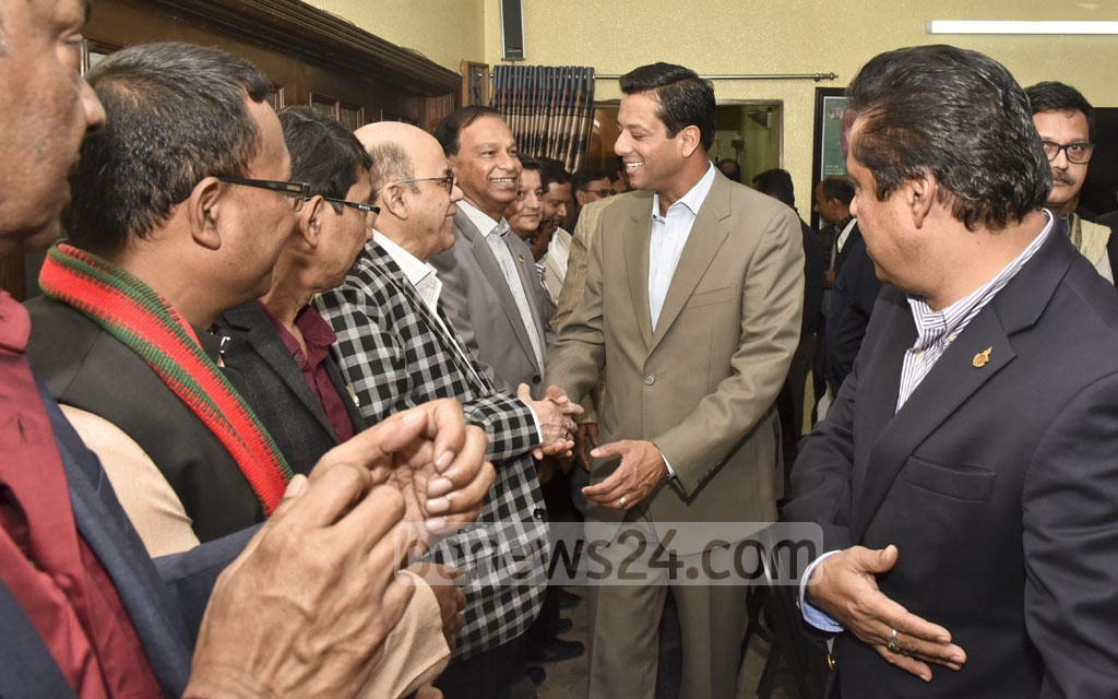 Prime Minister Sheikh Hasina's son and her ICT affairs adviser, Sajeeb Wazed Joy, is greeted by Awami League leaders when he arrived at AL chief's Dhanmondi office for a meeting on Monday.