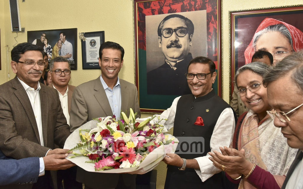 Prime Minister Sheikh Hasina's son and her ICT affairs adviser, Sajeeb Wazed Joy, is greeted with a bouquet when he arrived for a meeting with Awami League leaders at AL chief's Dhanmondi office on Monday.