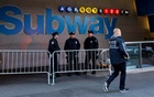 NYPD officers stand outside the New York Port Authority Bus Terminal subway station entrance after reports of an explosion, in New York City, US December 11, 2017. Reuters