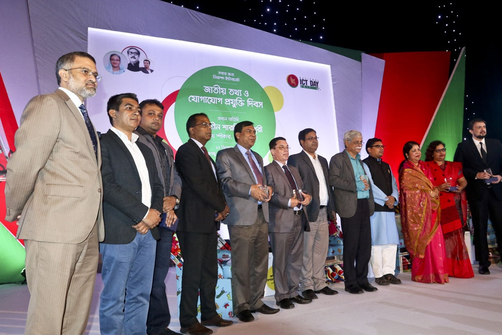 National ICT Award-2017 recipients pose for photo at the ceremony marking Bangladesh's first National ICT Day at the Bangabandhu International Conference Centre on Tuesday. Photo: dipu malakar