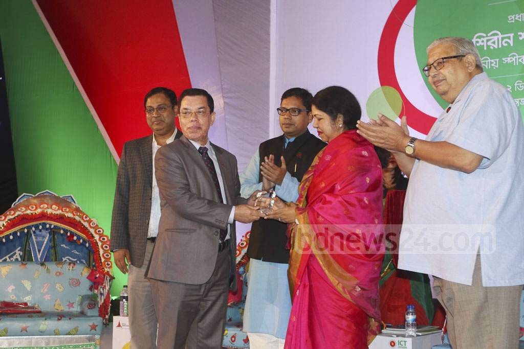 Vice Chancellor of the Shahjalal University of Science and Technology in Sylhet, Prof Fariduddin Ahmed receives award for the university's contribution in education sector at a ceremony marking the National ICT Day on Tuesday. Photo: dipu malakar