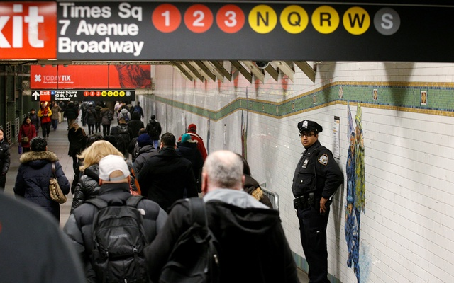 A New York City Police (NYPD) officer stands in the subway corridor, at the New York Port Authority subway station near the site of an attempted detonation the day before, in New York City, US, Dec 12, 2017. Reuters