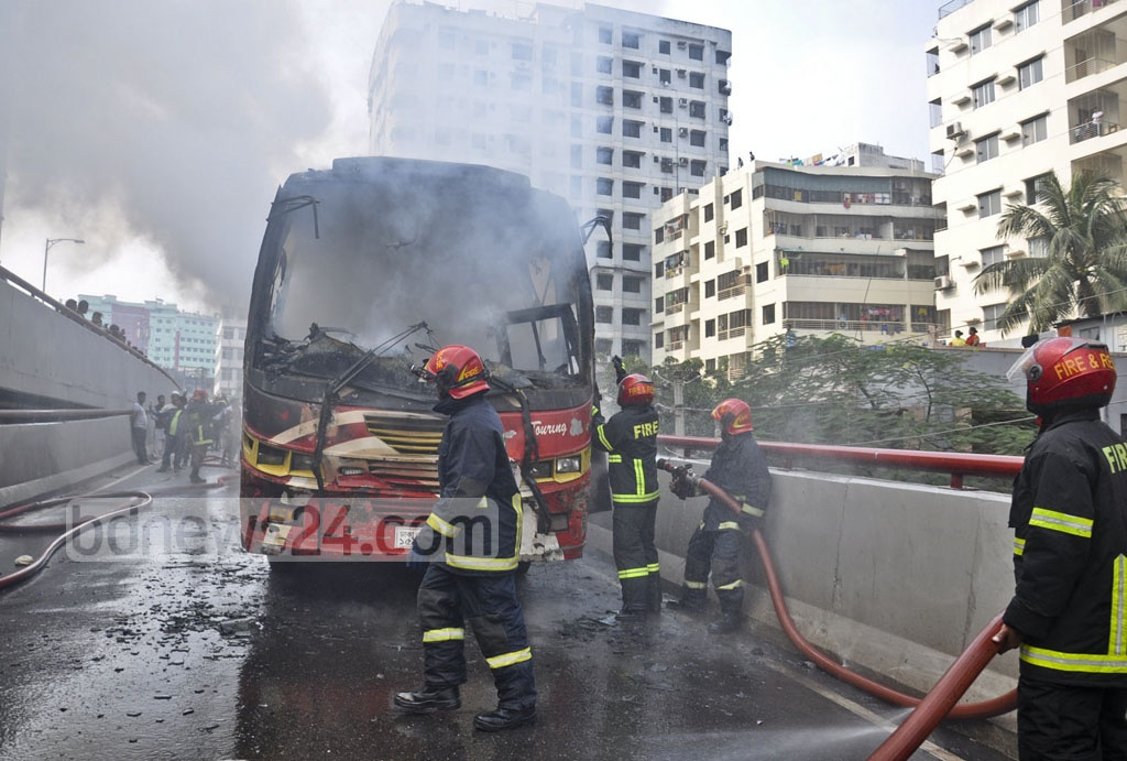 Fire crews put down flames of a bus that caught fire from a technical malfunction on the Moghbazar Flyover in the capital on Wednesday.