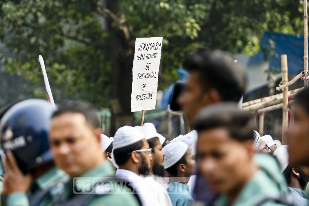 Activists of Qawmi madrasa-based organisation Hifazat-e Islam demonstrated near the Baitul Mukarram National Mosque in Dhaka on Wednesday protesting US President Donald Trump's decision to recognise Jerusalem as the Israeli capital. Photo: tanvir ahammed