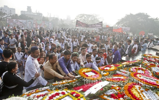 People commemorate Martyred Intellectuals Day at the memorial in Dhaka's Rayerbazar on Thursday. Photo: tanvir ahammed