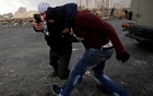 Undercover Israeli security personnel detain a Palestinian demonstrator during clashes at a protest against US President Donald Trump's decision to recognise Jerusalem as the capital of Israel, near the Jewish settlement of Beit El, near the West Bank city of Ramallah, December 13, 2017. REUTERS