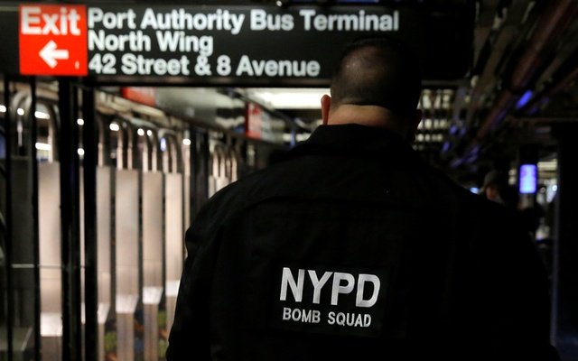 A member of the New York Police Department's Bomb Squad walks through the 42nd Street subway station beneath the New York Port Authority Bus Terminal following an attempted detonation during the morning rush hour, in New York City, New York, US, Dec 11, 2017. Reuters