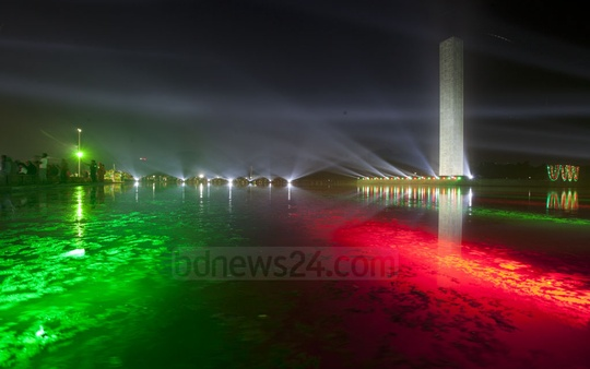 A visual treat: The Swadhinata Stombho monument in Dhaka's Suhrwardy Udyan lights up on Victory Day on Saturday. Photo: tanvir ahammed