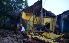 A man cleans up the wreckage of a house damaged by an earthquake in Sumelap Village, Tasikmalaya City, West Java, Indonesia Dec 16, 2017. Antara Foto via Reuters