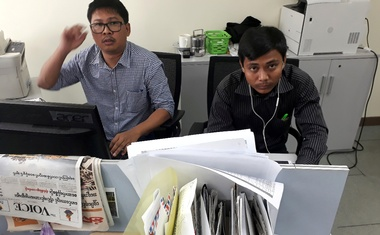Reuters journalists Wa Lone (L) and Kyaw Soe Oo, who are based in Myanmar, pose for a picture at the Reuters office in Yangon, Myanmar December 11, 2017. Reuters
