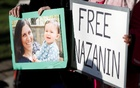 Demonstrators hold placards before a march in support of Nazanin Zaghari-Ratcliffe, the British-Iranian mother who is in jail in Iran, in London, Britain, Nov 25, 2017. Reuters