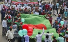 BNP activists carrying a large national flag at the Victory Procession that march through the capital starting from Naya Paltan party office to Mouchak on Sunday. Thousands of activists, supporters and leaders take part in the procession with banners, placards, national flags and party flags. Photo: tanvir ahammed
