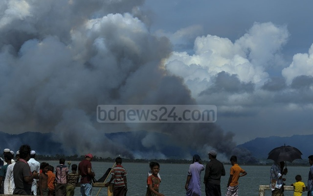 An estimated 655,000 Rohingyas have fled to Bangladesh since Aug 25. Smoke is seen near the Maugdaw township in Rakhine state in this photo taken on Sep 11 from Bangladesh's Cox's Bazar. Photo: mostafigur rahman/bdnews24.com