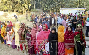 Voters queue at a polling station during Rangpur City Corporation election on Thursday.