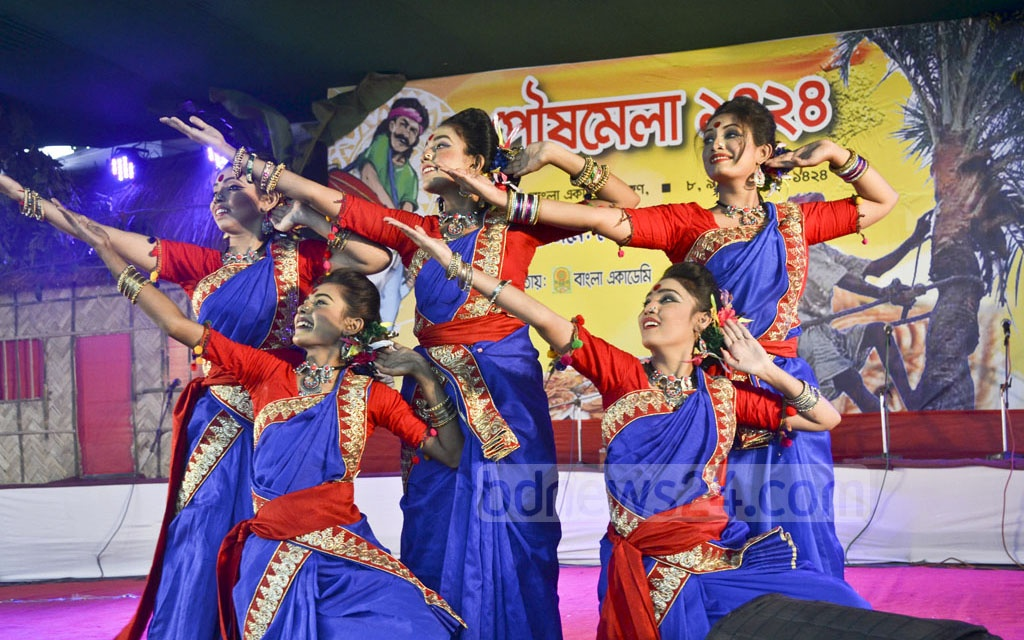 A group of dancers performing at the inauguration of the three-day Poush Mela 1424 at the Bangla Academy premises on Friday.