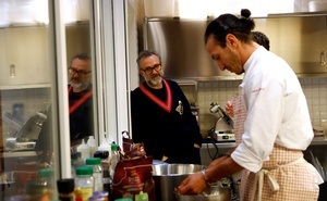 Michelin-starred chef Massimo Bottura looks at a staff member working at Refettorio Ambrosiano in Milan, Italy Dec 18, 2017. Reuters