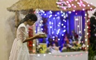 A child prays at the Holy Rosary Church in Farmgate in the early hours of Christmas Day. Photo: tanvir ahammed