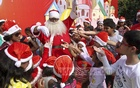 Children receive presents from Santa Claus at a hotel in Dhaka on the Christmas. Photo: dipu malakar