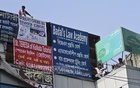 The Dhaka North City Corporation removes illegal billboards, banners and festoons in Dhaka's Green Road on Thursday. Photo: dipu malakar
